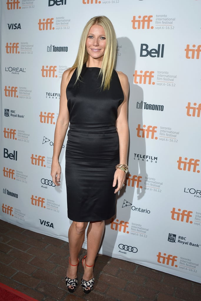 Gwyneth Paltrow joined her Thanks For Sharing costars Mark Ruffalo, Tim Robbins, Josh Gad, and Patrick Fugit on the red carpet at the Toronto International Film Festival tonight. She accented her black dress with red animal-print heels to pose for the cameras. Gwyneth made the trip up north after popping up in LA for the annual Stand Up to Cancer telethon yesterday. She not only attended the event but was also an executive producer. Gwyneth talked about how losing her father to cancer changed her habits and made her take another look at her own health — see all the other stars that participated in Stand Up to Cancer's big fund-raising night here!