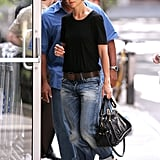 From her fancy fedora to her cuffed boyfriend jeans to her fearless mix of black and brown, there are so many reasons why we love this late-Summer 2008 look.
