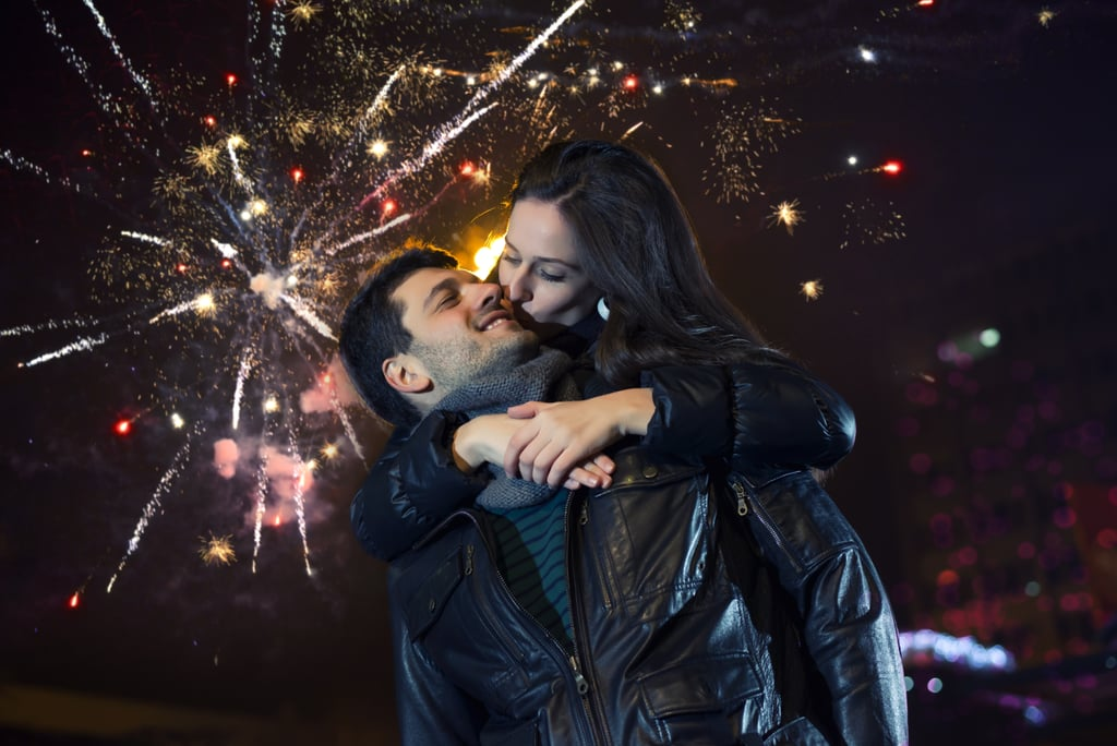 Kiss under fireworks.