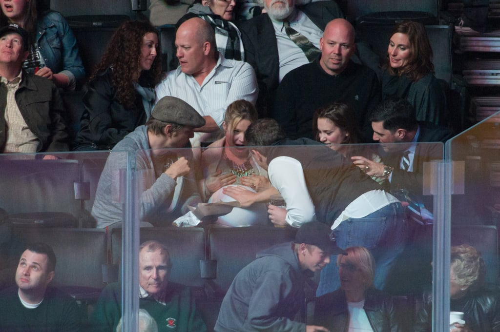 Kristen Bell got a baby bump belly rub at the Kings game on Wednesday night.