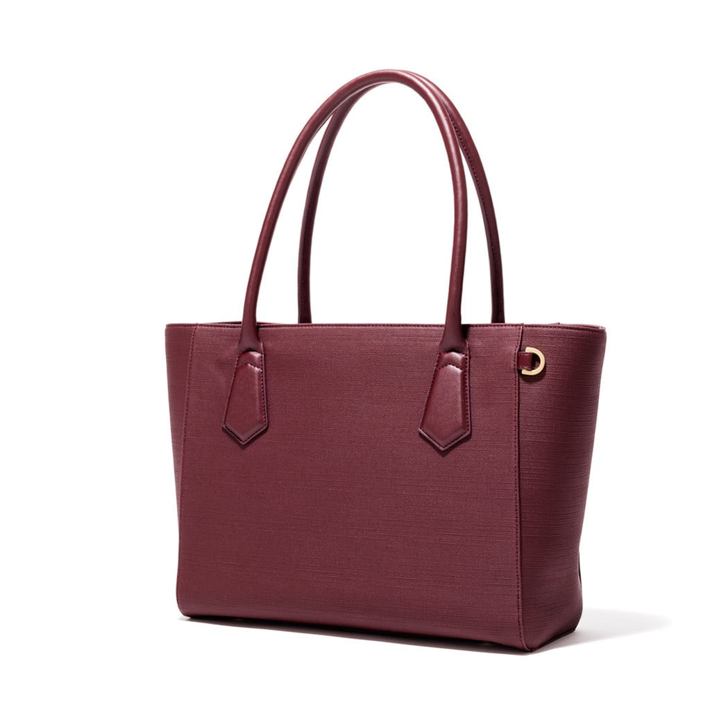 "This Dagne Dover tote ($255) is the work-to-happy-hour carryall I've been searching for! It just has so many compartments, is roomy enough to fit all my stuff, and comes across as elevated rather than your typical, bulky ""laptop bag.""	 — SS"