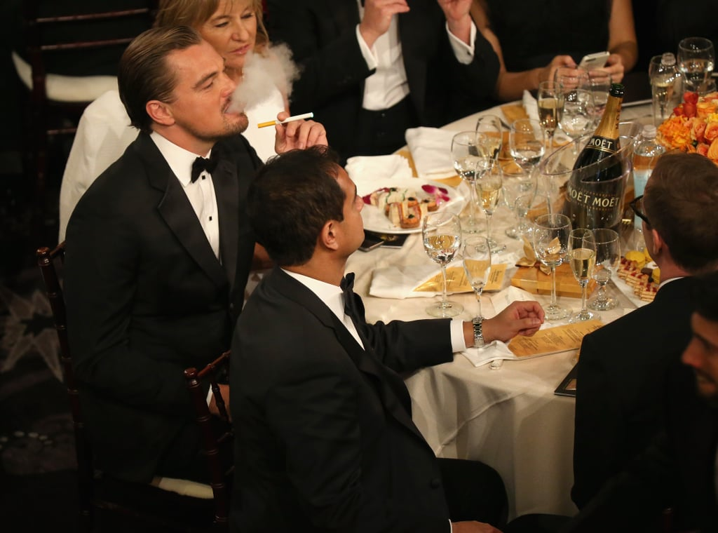 At the Globes, Leonardo DiCaprio lit up an electronic cigarette at his table, where he sat with the rest of his The Wolf of Wall Street cast.  Source: Christopher Polk/NBC/NBCU Photo Bank/NBC
