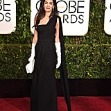 For the 2015 Golden Globe Awards, Amal wore a black Dior gown and white gloves.