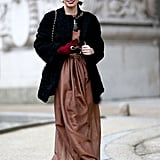 Day glamour in the form of a floor-length dress and furry coat.