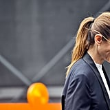 A swept-back ponytail can be surprisingly chic — and refreshingly easy.
