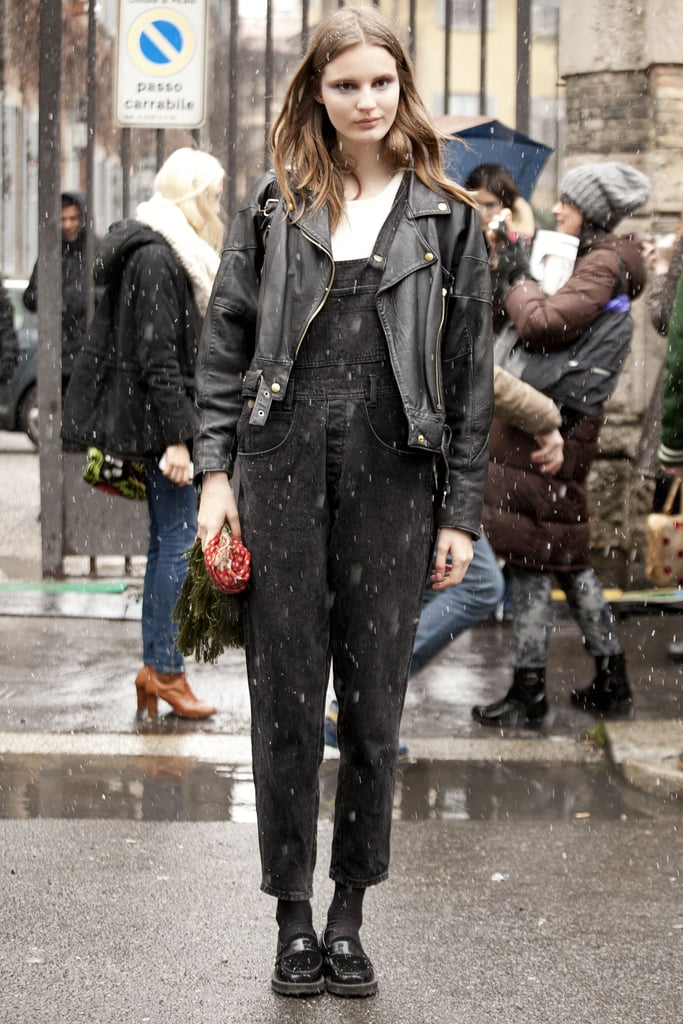 A '90s moment in overalls, loafers, and a leather jacket.