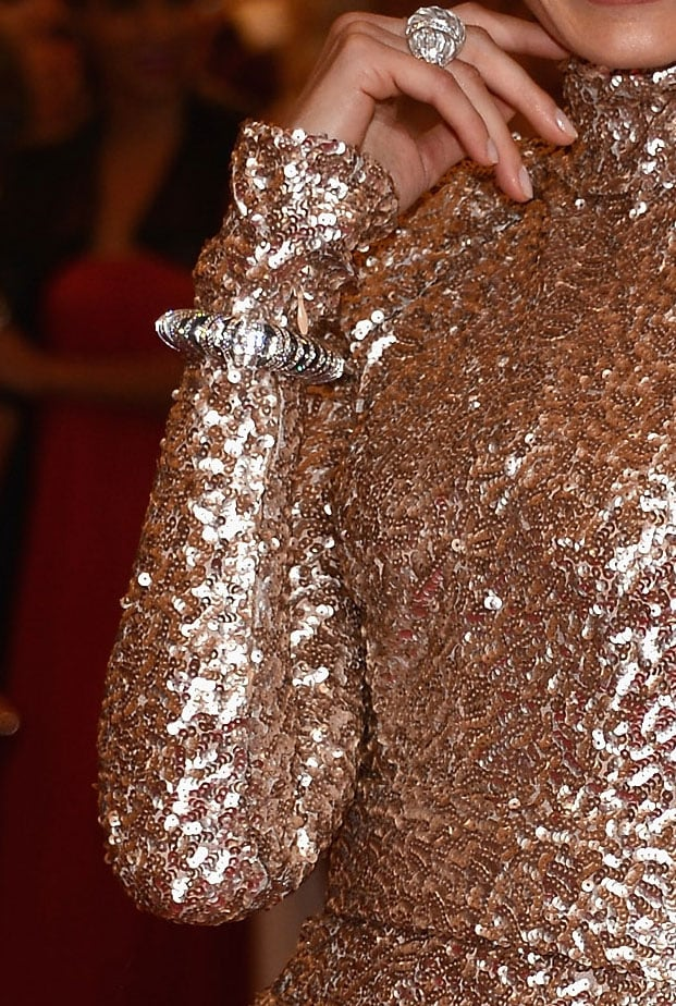 Karolina furthered the glamour with a decadent bangle and ring.