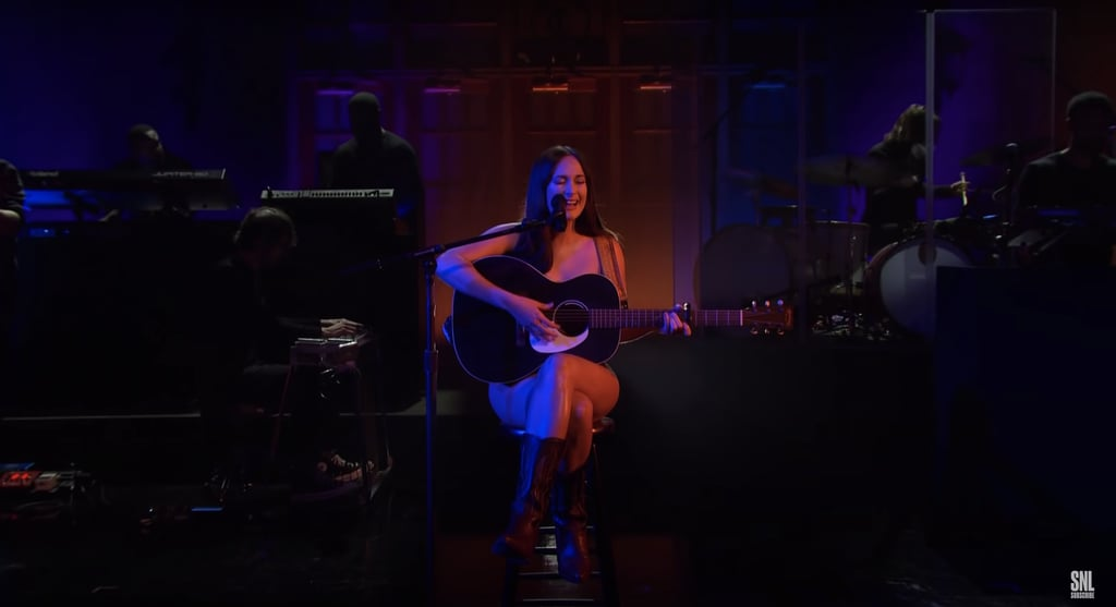 """Kacey Musgraves's return to Saturday Night Live on Oct. 2 was a memorable one. For a stripped-down rendition of """"Justified,"""" she sat on stage wearing nothing but Celine boots and her guitar, a scene which she later revealed was inspired by Jenny from Forrest Gump. While Kacey paid homage to the movie character's strip-club performance, the signature cowboy boots were all her. I mean, if you're going to wear just one clothing item on stage, make it Celine.  Earlier in the episode, the singer wore a brown corset top and matching leather pants, while she changed into a casual cropped flannel shirt and jeans to perform her track """"Camera Roll."""" Check out Kacey's vulnerable performance ahead, and get a closer look at her western boots.      Related:                                                                                                           Cowboy Boots Aren't Going Anywhere This Spring— in Fact, They're Better Than Ever"""