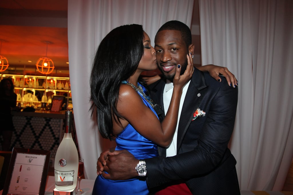 Gabrielle gave Dwyane a cute kiss on the cheek during a New Year's Eve party in Miami back in 2011.