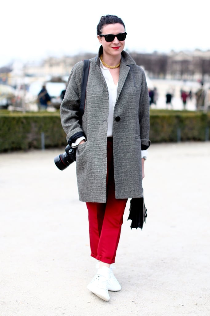 Garance Doré showed off her style in front of the camera in bold trousers and a menswear-inspired coat.