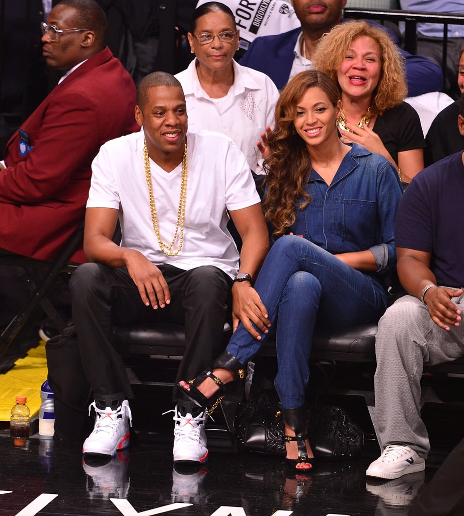 Beyoncé and Jay Z cracked up while watching the Brooklyn Nets game on Monday, letting loose during game four of the NBA Playoffs match against the Miami Heat in NYC. The pair's sporty date night came after the release of video footage showing Beyoncé's sister, Solange Knowles, attacking Jay Z in an elevator last week following a Met Gala afterparty. In the video, Solange can be seen punching and kicking her brother-in-law before she's restrained by a bodyguard. It isn't clear what caused the buzzed-about incident, but if Beyoncé and Jay Z's smiley date night is any indication, it looks like they aren't too fazed by the headlines. Take a look at the couple's sweet courtside interaction below.