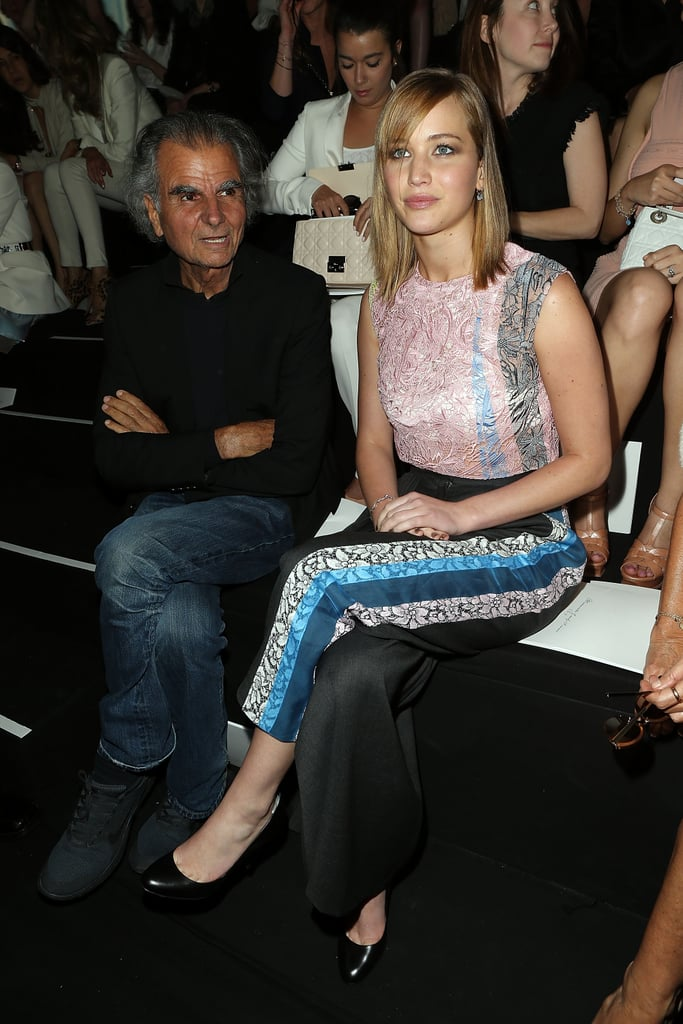 Jennifer Lawrence took her front-row seat next to fashion photographer Patrick Demarchelier at the Christian Dior Haute Couture runway show on Monday.