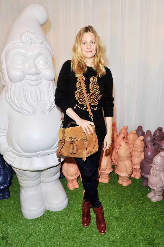 Romola Garai wore Mulberry's Double Tiger Motif Jumper in Black Angora, Dorset Booties in Black Forest and carried the Tassel Bag in Oak Suede from the Autumn Winter 2012 Collection.