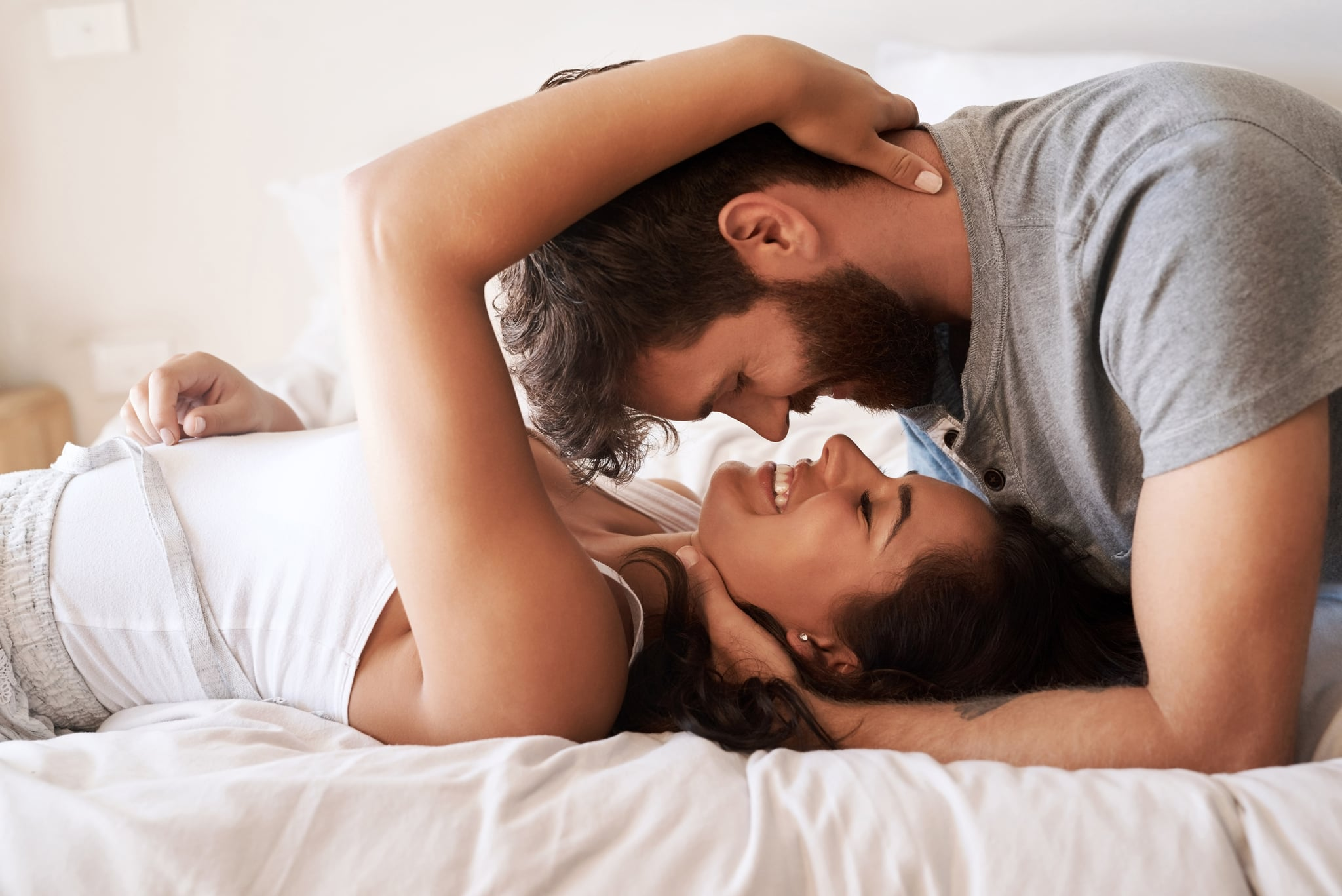 Shot of an affectionate young couple sharing a romantic moment in the bedroom at home