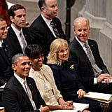 The Obamas sat beside Vice President Joe Biden and Dr. Jill Biden.
