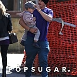 Orlando Bloom carried Flynn on a walk.
