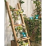 This teak ladder and shelf ($149) is a simple, but stylish organization option. You can hang planters on its many rungs and display candles on the shelf.
