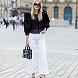 Play with proportions with cropped jeans and a voluminous top