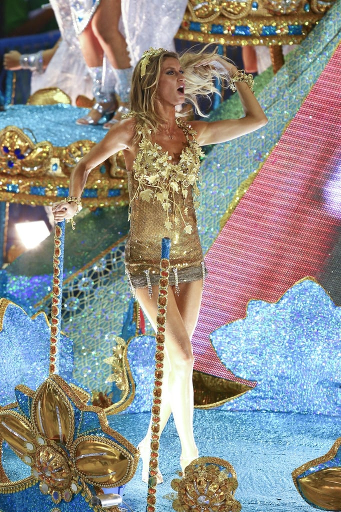Gisele Bundchen kept the good times coming in Rio last night by joining her husband, Tom Brady, at the Carnival celebrations. She kicked off their fun in a gold Venus de Milo costume to ride on a float sponsored by the Vila Isabel Samba School, shaking it alongside her mom and sisters-in-law Nancy and Julie Brady —the ladies showed off their fancy footwork after having some recent dance lessons! Tom, though, couldn't get in on the action due to an injury. Gisele later changed into a Pantene t-shirt appropriate considering her spokesmodel duties. She and Tom haven't wasted any time during their trip away, as they arrived in her home country of Brazil on Saturday and she was quick to slip into her bikini to lounge by the pool yesterday afternoon.