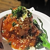 This meatball was served with a delicious broccoli rabe.
