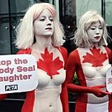 Two half-naked women protest the use of seal products outside the Canada Trade Office in Taipei.