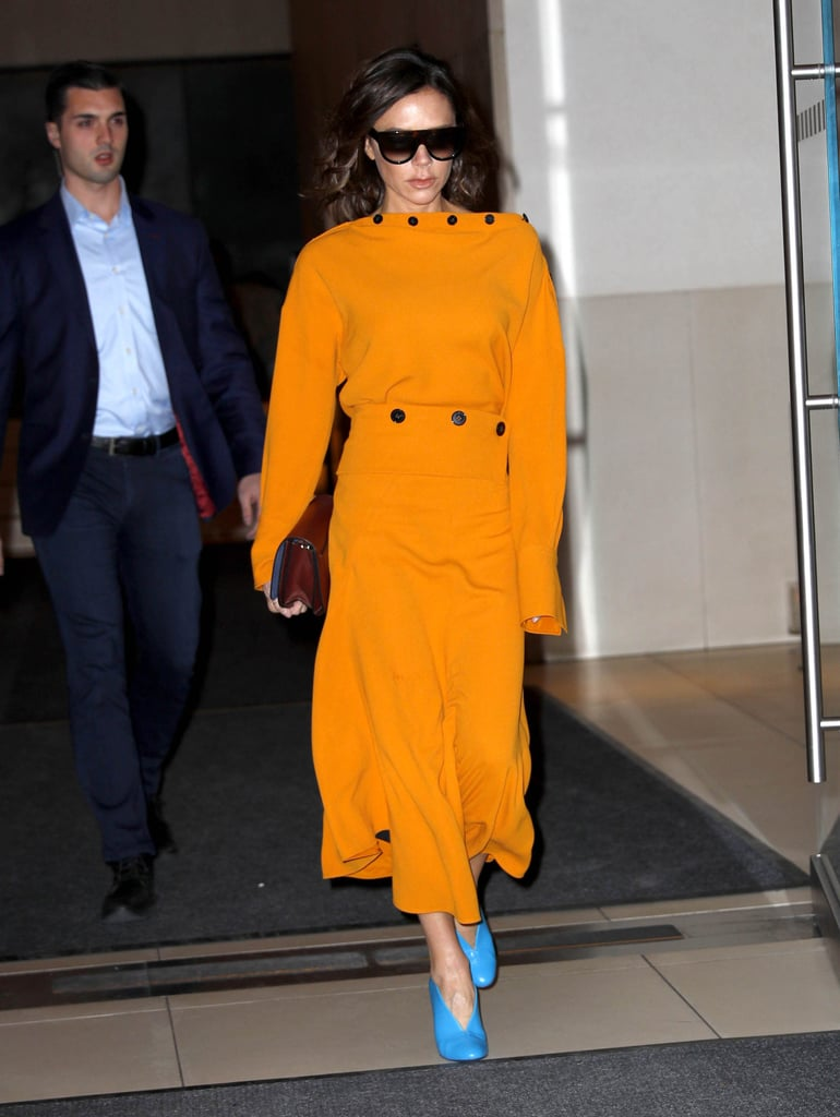 For a day in New York, Victoria wore a mustard dress, which she paired with bright blue glove heels.