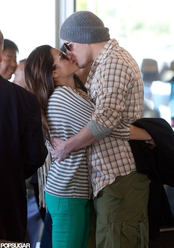 Channing Tatum and Jenna Dewan shared a sweet kiss while waiting for their car outside of LAX in February 2012.