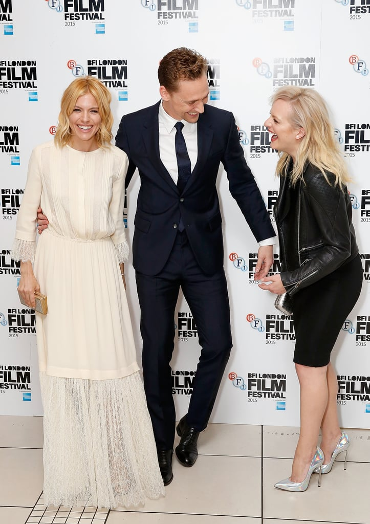 Sienna Miller and Tom Hiddleston attended the London premiere of their new film, High-Rise, on Friday. Sienna and Tom kept their streak of cute moments going, sharing plenty of laughs with their costar Elisabeth Moss on the red carpet. Luke Evans was not in attendance, but he did appear alongside Sienna and Tom at the San Sebastián International Film Festival in Spain back in September. Read on to see more photos from the trio's night out, then check out Tom's crazy-good Robert De Niro impression.