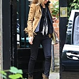 Kate Moss added major bohemian-cool flair to her London look via a tan fringe jacket.