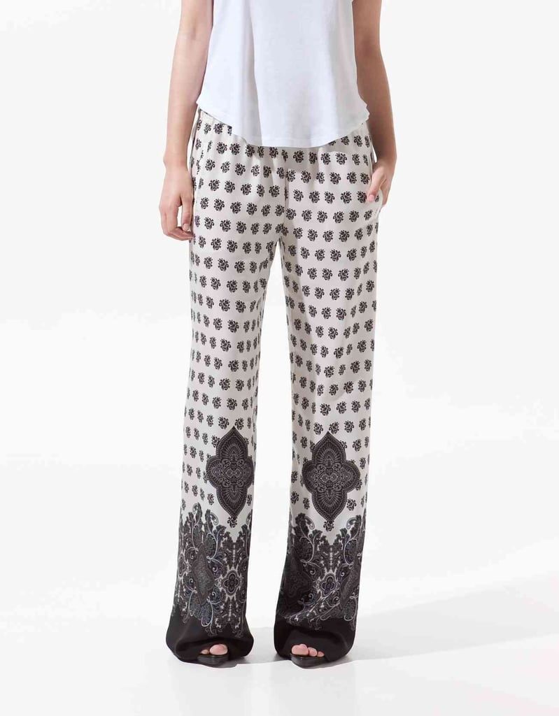 """""""Aside from the gorgeous print, I'm loving the fact that I can get away with wearing my pajamas outside of the house — and look pretty chic doing it. I'm officially on the pajama-trend band wagon."""" — Hannah Weil, associate editor  Zara Printed Trousers ($80)"""