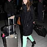 Jessica Alba maneuvered her luggage through the terminal.
