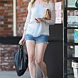 Kirsten Dunst leaves a convenience store after picking up a few items.