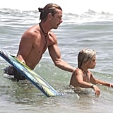 Shirtless Gavin Rossdale helped Kingston Rossdale navigate the waves.
