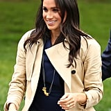 Meghan received a gold painted pasta necklace from a boy named Gavin during an appearance, which she gratefully accepted and wore proudly.