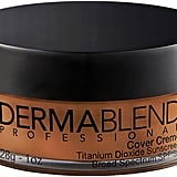 """""""The Dermablend Cover Creme Full Coverage Foundation ($39) is my favourite foundation for outdoor weddings, brides with skin conditions, or events taking place in hot climates. It is a velvety cream foundation with a 16-hour smudge and transfer-resistant wear. Plus, is contains an SPF 30, to protect the skin from sun exposure. It has a high concentration of pigments to cover a variety of skin conditions including birthmarks, acne, burns, scars, hyperpigmentation, and vitiligo. For oily skin types pairing it with a mattifying setting powder."""" — LS"""