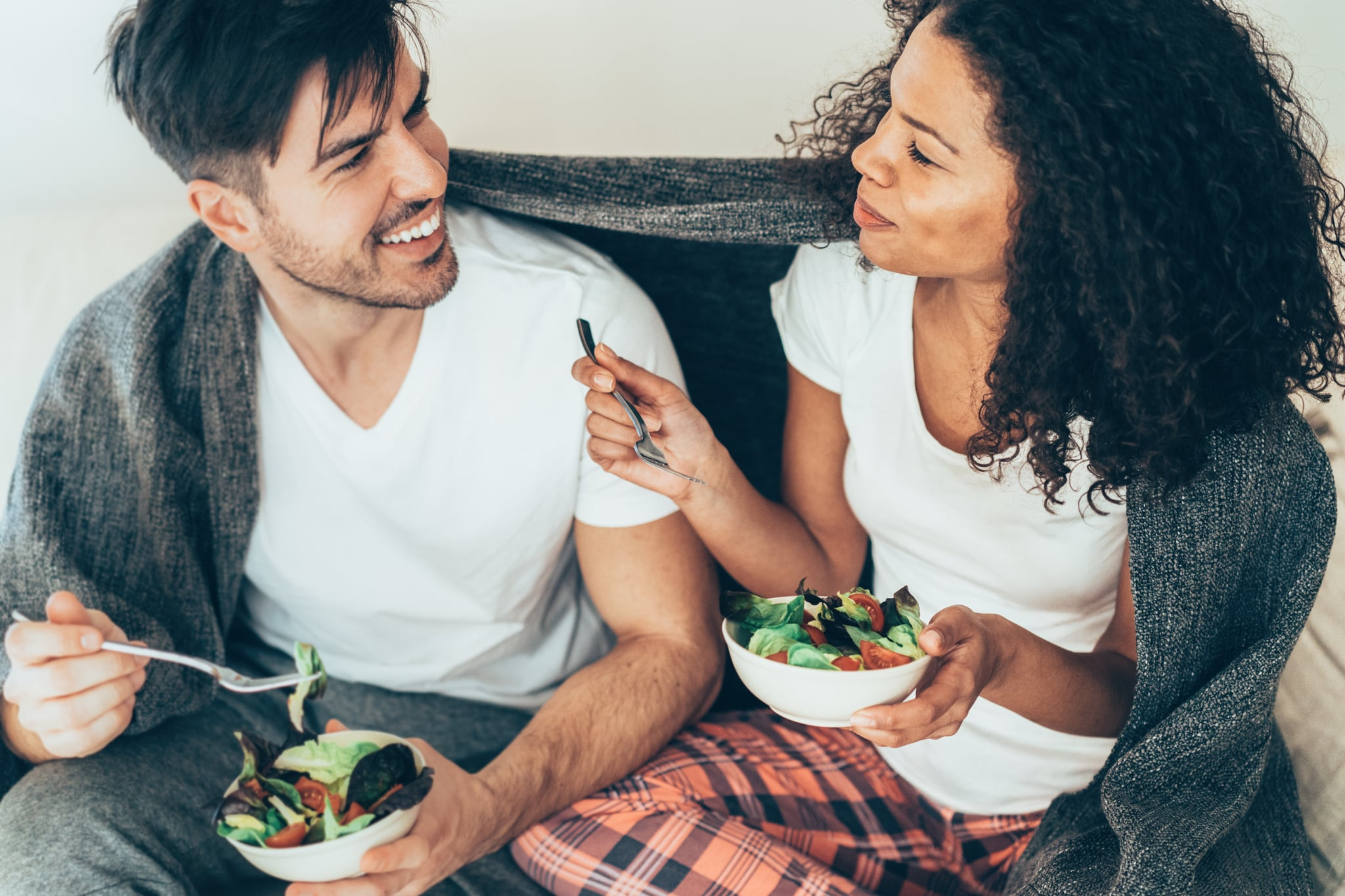 Beautiful Couple in love eating salad together