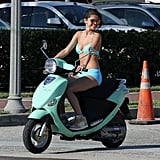 Selena Gomez looked both ways before crossing the street with her scooter.