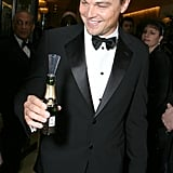 A suited-up Leonardo DiCaprio got ready to pop some bubbly at the Golden Globes in January 2007.