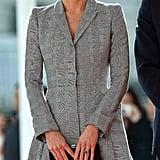 Wearing a tailored Alexander McQueen coat.