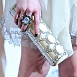 Emma Roberts wore a chunky ring and embellished box clutch. Cool choice.