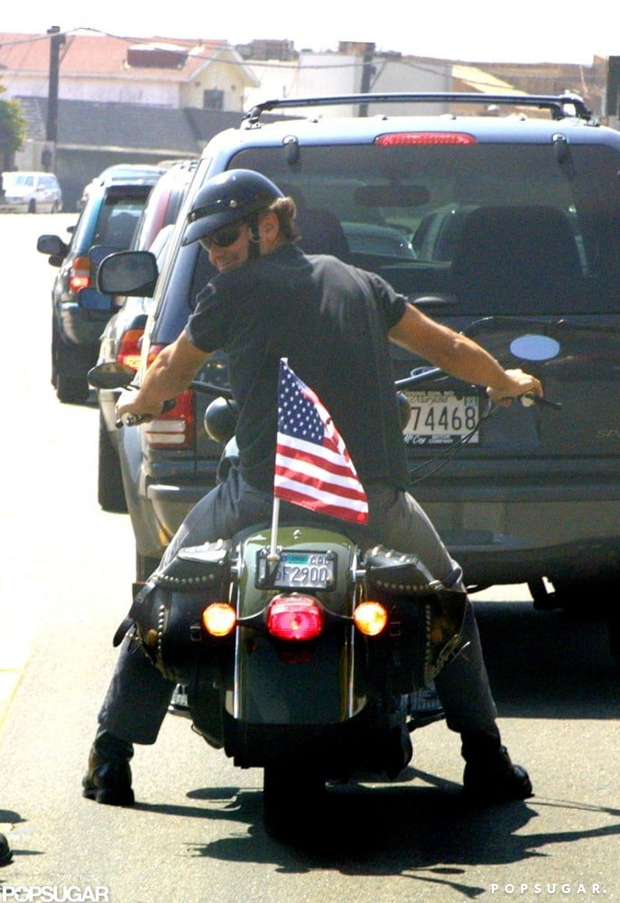 George Clooney waved his American pride on the back of his motorcycle while riding around LA in September 2001.