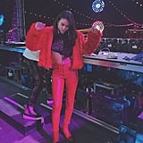 Shanina Shaik Wearing a Red Fuzzy Coat With Leather Boots by Modern Vice