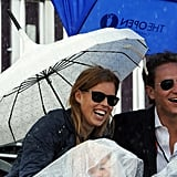 They braved the rain to attend the London Olympics.