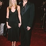 Jennifer wore a black halter slipdress and a satin wrap for an American Film Institute soiree in 2000. Brad Pitt looked equally dashing in a black suit and sheer embroidered shirt.