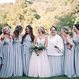 The seven bridesmaids pictured all looked stunning in their blue-gray dresses.