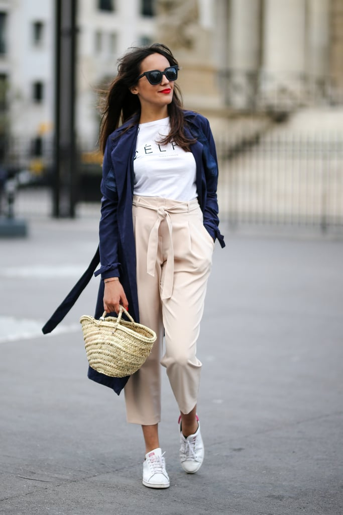 Style a luxe outfit with a straw bag and sneakers.