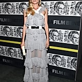 Diane Kruger again proved her fashion-forward status choosing a tiered Prabal Gurung gown, featuring a white leather and metal belt and sheer ruffled skirt, for a MoMA event honoring Quentin Tarantino in December 2012. Ladylike accessories — feathered earrings and a quirky Charlotte Olympia clutch — completed her flawless party style.