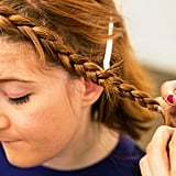 Keep braiding all the way to the end, and secure with a clear elastic. There are also black elastics for darker hair colors. Source: Caroline Voagen Nelson