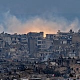 Smoke and flames rise from buildings in Aleppo's al-Zabdiya neighborhood after government strikes on Dec. 14.