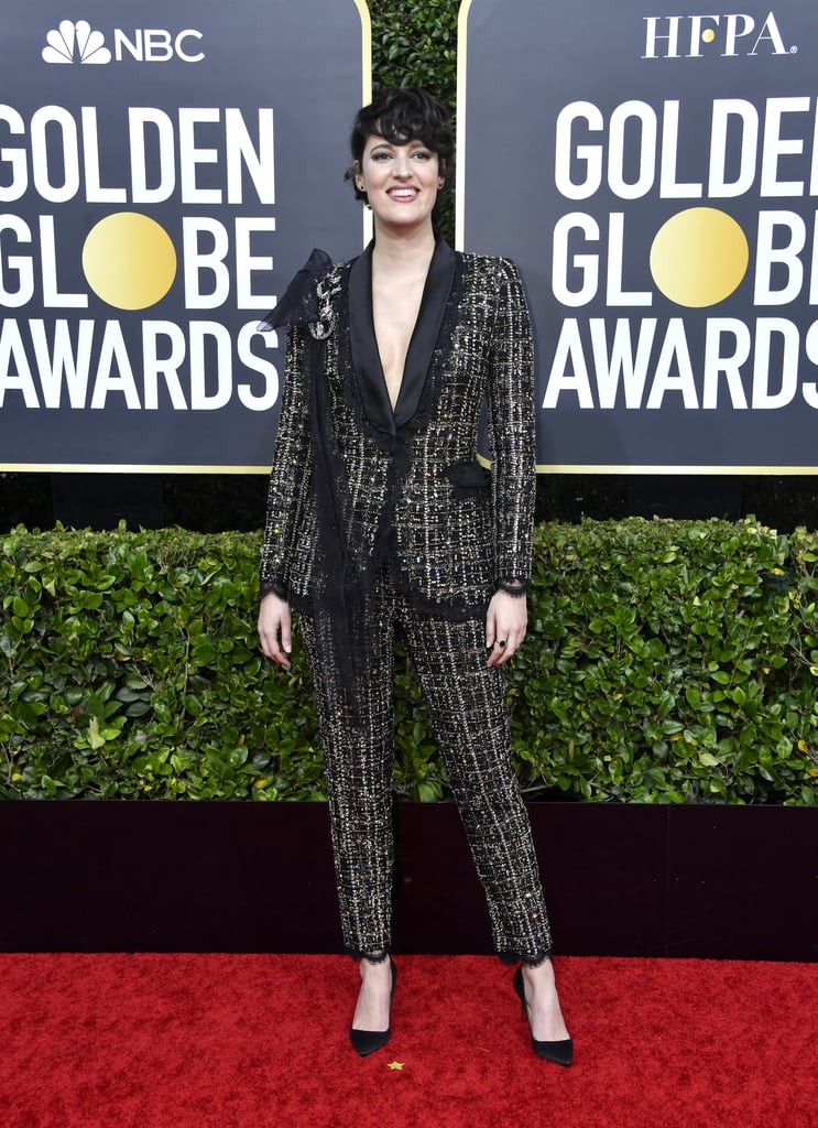 Phoebe Waller-Bridge is putting the power in power suit. On Sunday night, the fabulous creator of Fleabag arrived on the Golden Globes red carpet making a statement in her stunning two-piece tweed suit. The low-cut ensemble featured metallic threading and a detailed pin on one shoulder.  It was a big night for Phoebe, as she's won a Globe for best actress in a TV musical or comedy for Fleabag, while the show took home the award for TV series, musical or comedy.